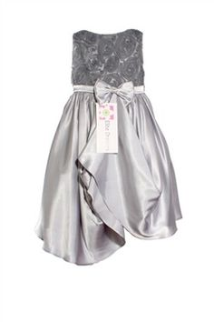 Your little girl will love how she looks in this sleeveless formal dress embroidered with a lovely rosette pattern on the bodice. It has a layered satin skirt pinned with a dazzling bow with rhinestones in the middle. Your daughter will feel so beautiful in this stunning shimmering gown. In Black, Champagne, Ivory, White and Silver