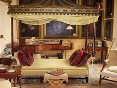 One of the pair of eighteenth-century chinoiserie canopied sofas at Stanway House, Gloucestershire.