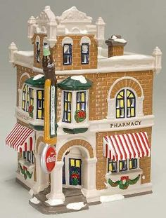 Department 56 Snow Village Coca Cola Shop -- This is an Amazon Affiliate link. Be sure to check out this awesome product.