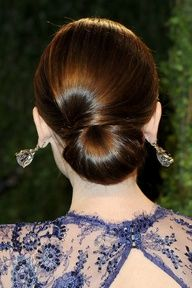 Lily Collins fanned-out bun
