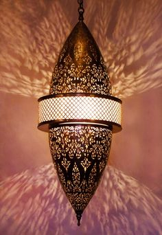 Moroccan brass ceiling lamp, pendant light egg shape with its outstanding chiselled openwork lys flowers. Moroccan Decoration