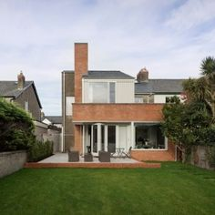 GKMP+Architects+uses+pebbledash,+brick+and+slate+for+Dublin+house+extension