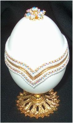 1901. The 'Gatchina Palace' Faberge Egg - for Tzar Nicholas. The egg opens to reveal a miniature gold replica of the palace at Gatchina