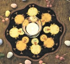 spring chicks candle mat on wool