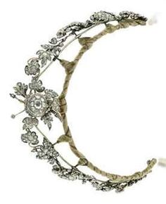 AN ANTIQUE DIAMOND NECKLACE/TIARA  Designed as a series of rose-cut diamond leaves to the central floral spray, closed back setting, mounted in silver and gold, converts to form a necklace, mid-19th century, as necklace 37.0 cm long