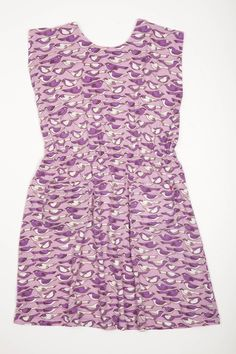 A chic cinched waist dress with front pockets.