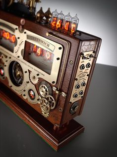 handmade vintage industrial steampunk clock made from nixie tubes and ww11 spitfire