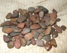 River Pebbles undrilled various sizes and shapes great brown color natural stones P28. $4.99, via Etsy.