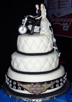 3 tier~Marshmallow fondant Harley Wedding cake. Chocolate, Carrot, and French Vanilla cake with Buttercream frosting.