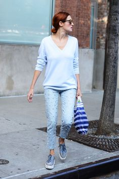 TTH in a light sweater and embellished denim