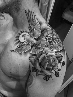 a look at some black and grey tattoos rose tattoo religious tattoos greek statue tattoos sleeve tattoos and skull tattoos. Dove Tattoos, Skull Tattoos, Flower Tattoos, Body Art Tattoos, Sleeve Tattoos, Dove And Rose Tattoo, Guy Chest Tattoos, Dove Neck Tattoo, Statue Tattoo