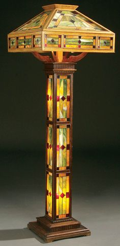 A Large Arts & Crafts Leaded Glass and a Oak Floor Lamp, circa 1910.