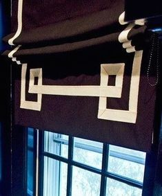 Great shade! black roman shade with white Greek Key trim detail in a black room - very chic! www.normandeauwc.com/