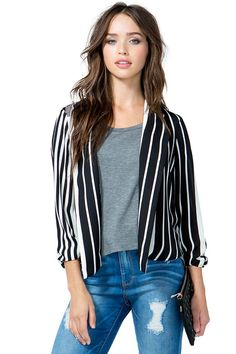 A relaxed, monochromatic blazer featuring stripes and an open front. Notched lapels. Ruched half sleeves. Finished hem. Lightweight.
