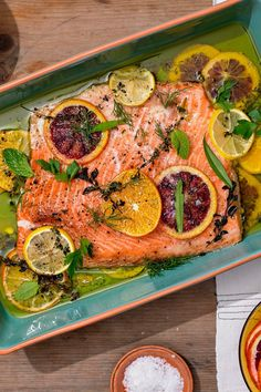 NYT Cooking: This is truly the best way to cook salmon. Slowly roasting an already fatty fish in a generous amount of luxurious fat (here, one and a half cups of olive oil) makes it nearly impossible to overcook. Plus, you can flavor that oil with whatever you fancy — spices, herbs, citrus, chiles — which, in turn, will flavor the fish. It's a very simple method for cooking any large piece of fish (cod or h...
