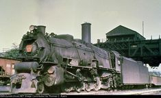 """Here is a duplicate 35mm color slide that was taken in Denholm, Pennsylvania. Shown here is Pennsylvania Railroad engine #6967, an M-1 (4-8-2) """"Mountain"""" built by the Baldwin Locomotive Works during December of 1926 and retired in June of 1959. In this context, it's passing under the Denholm Coaling Wharf with a mixed-cargo freight train on its way to the Enola Yards."""