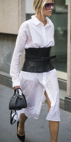 A leather corset over a white shirt dress