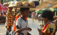 This candid shot is of some Khmer children on the tourist beach carrying and selling fruit to foreign tourists (aka farangs) in Sihanoukville, Cambodia. Battambang, Cambodia Travel, Phnom Penh, Angkor, Travel Photos, Travel Inspiration, Children, Kids, Fruit