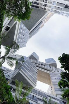 Apartment blocks become an interconnected tetris-like village in this Singapore housing development by OMA!