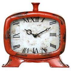 """Bring chic style to your side, table, console, or desk with  lovely accent.    Product: Table clock    Construction Material: Iron    Color: Antiqued orange    Features: Roman numeral numberingOld World charm  Dimensions: 8.5"""" H x 9"""" W x 3.5"""" D    Cleaning and Care: Wipe clean with damp cloth     Shipping: This item ships small parcelExpected Arrival Date: Between 04/22/2013 and 04/30/2013Return Policy: This item is final sale and cannot be returned"""