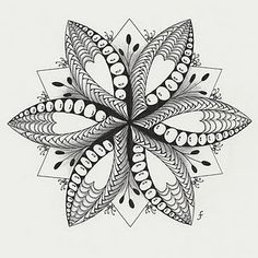 zentangle flower / star. How about mandalas Claire