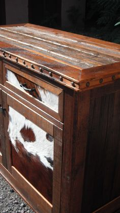 Western Heritage Furniture's small buffet made of reclaimed barnwood with hair on hide panels