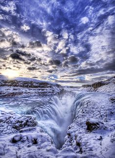 This is Gulfoss, the frozen waterfall in Iceland. Dark age theologians used to believe this was the entrance to hell, which was originally a cold place; the innermost circle of Dante's version was frozen. True believers would come here and cast themselves down into the chasm to try to rescue souls they were told had gone to hell.