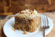 Lazy Daisy Coconut Oatmeal Cake~T~Love this easy cake. The topping of butter, brown sugar, milk, coconut and chopped walnuts or pecans is spread on top of the warm cake and then put under the broiler to melt and toast the coconut. Yum.