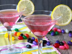 Jelly Bean Martini (3 oz (6 tablespoons) cotton candy-flavored vodka 1/4 cup red and pink jelly beans Ice 2 oz (1/4 cup) orange-flavored liqueur (or your favorite flavor) Garnishes 6 red or pink jelly beans 2 lemon slices)