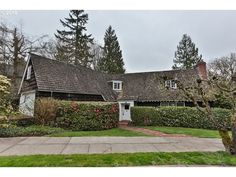 Period-Perfect Pick of the Week: 1937 Arlington Heights (SW) English Traditional, Cape Cod? I don't know what to call this but CHARMING! With walls of fabulous paneling and built-in shelving, diamond mullion leaded glass windows; multi-pane wood casement and bay windows; a vintage kitchen with 50's Flair oven, eating nook and wallpapered ceiling; cozy kids bedroom with whitewash paneling and porthole windows;  vintage bathrooms with original fixtures and flooring, etc! 4/2 4189sf, $725,000.