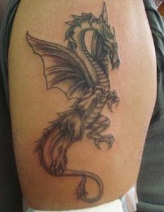 dragon tattoos for men on shoudler http://tattootodesign.com/dragon-tattoos/