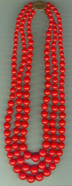 In the old days these red beads would have been made of real coral.  Today the Poles use a much less expensive substitute (polystyrene).  Th...