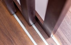 Sliding Wall Panels | Custom-built sliding panels with stained walnut, frosted acrylic and ...