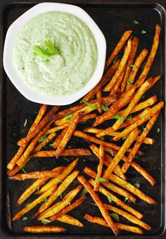 Crispy, oven-baked curry fries served with a cilantro mint yogurt dipping sauce from A Duck's Oven. Perfect as an appetizer or a side!