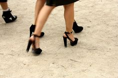 Quintessential Paris Fashion Week - (high) heels marching over the yellow gravel covered parisian walkways.