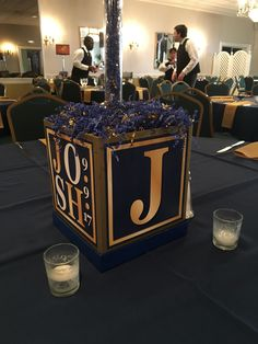 The centerpiece base was a cube featuring the blue and gold logo. The top was a foam board sign that looked like a flat screen TV. On the screen was the TV show the table was named for. Graphic Design Services, Gold Logo, Logo Color, Bar Mitzvah, Event Decor, Service Design, Favorite Tv Shows, Cube, Centerpieces