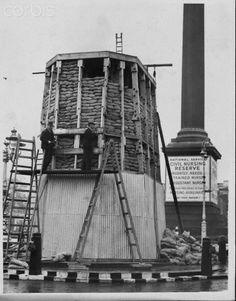 Protecting King Charles Statue Against Air Raids, 1939. Original caption: Under Cover. The King Charles statue in Trafalgar Square is receiving protective covering in the form of numerous sandbags & corrugated iron. Photo shows: Air Raid Precautions for the King Charles statue at Trafalgar Square this morning, showing Nelson's Column in the background.