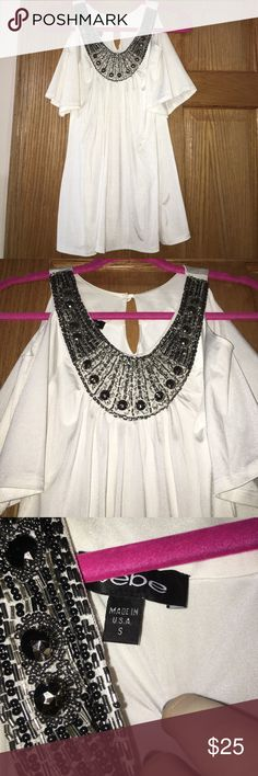 NWOT Bebe top with neckline embellishments Fantastic Bebe top with beautiful embellishments to give you a necklace effect. Simply stunning and is not your ordinary top! So beautiful ! Materials are photographed bebe Tops Blouses