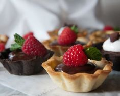 Chocolate or vanilla crust mini-tarts filled with a decadent but easy bittersweet chocolate ganache.