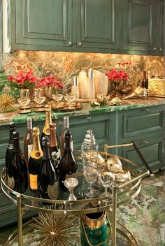 Wow factor .//. amazing kitchen and bar cart, such warmth .//. Kelly Wearstler