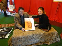 Artist M.Bugi Presenting a Graphic work to Lilian,Of Stads Gallery Breda Nederland-on the time of My Group Show that Opened First Saturday of Feb 2013.