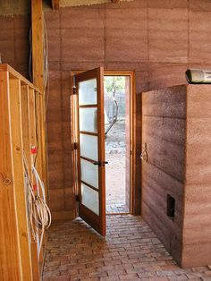 Rammed Earth House - Bedroom Door To Outside