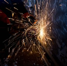 sparks from metal on construction site as background