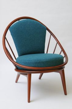 Early Ib Kofod Larsen Spindle Back Peacock Lounge Chair | From a unique collection of antique and modern lounge chairs at http://www.1stdibs.com/furniture/seating/lounge-chairs/