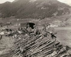 The surrender of the 19th Army. With the final capitulation of Germany to the Allies, German soldiers who have bore arms for over five years against almost all of Europe and the U.S., surrender their rifles to their American conquerors near Landeck, Austria