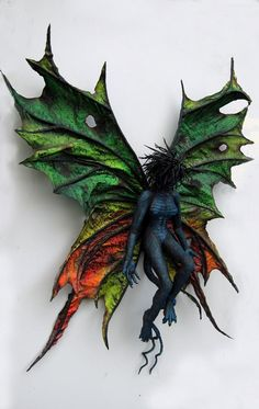 Dan Reeder's Paper Mache Dark Butterfly. Love his techniques and the paint scheme on this piece.