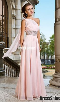 One shoulder pale pink dress with crystals at waistline and a trailing shoulder cape.