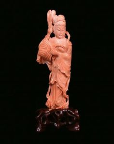 A rose coral female figure, China, early 20th century : Lot 686