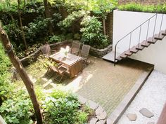Julian-King-Architect-Chelsea-townhouse-reused-brick-pavers-in-garden-cantilevered-ipe-stairs