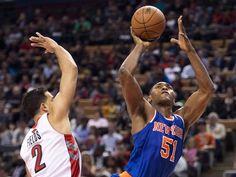 New York Knicks forward Matta World Peace (51) drives past Toronto Raptors forward Landry Fields (2) during first half NBA pre-season basketball action in Toronto on Tuesday, Oct. 21, 2013. (AP Photo/The Canadian Press, Nathan Denette)